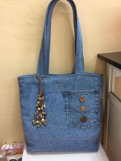 Denim gift bag by touchofdenim on etsy – Artofit Denim Tote Bags, Denim Purse, Jean Purses, Purses And Bags, Artisanats Denim, Blue Denim, Denim Crafts, Quilted Handbags, Recycle Jeans