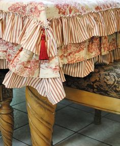 A pretty ruffled tablecloth but it would have to fit the table perfectly to look really great.