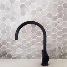 Marble hex tiles and matte black tap ware