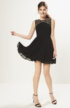 Such a pretty embellished v-back fit & flare dress. Will pair nicely with gold or black sandals.