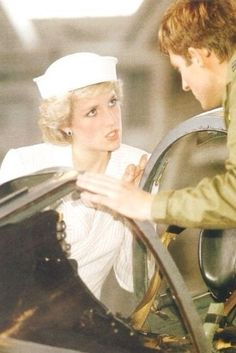 September 25, 1985:  Princess Diana speaking with Flight Lieutenant Steve Fox who explains the operation of the control panel inside the cockpit of a Harrier Jet.