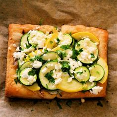Everything about this summer squash tart is great, from the ricotta-parsley spread to the caramelized onions to the blanched squash rounds to the barely melted feta crumbled on top at the last moments of baking. Zucchini Squash, Frozen Puff Pastry, Summer Squash, Looks Yummy, Caramelized Onions, Kitchen Recipes, Quick Meals, Main Dishes, Side Dishes