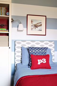 IKEA Hack Ideas to Customize Kids Beds, I love the color combo, and the reading light in the built-in shelf is a cool idea
