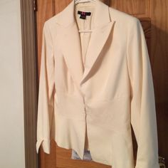 NICE JACKET FOR WORK OR PLAY Pretty embellished suit jacket. Cream in color. Cute button accent on cuffs. Fastens at waist with 3 hidden slip clasps. Also looks great with jeans. N Company Jackets & Coats Blazers