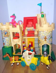 Fisher Price castle! My sisters got our parakeet stuck in the dungeon when they were little (before I was born). Don't worry -- both the parakeet and the castle were ultimately unharmed.