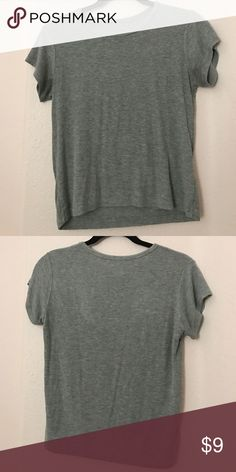 """Grey soft shirt Grey cute really soft shirt from brandy Melville the brand tag thing came off but that's where it's from. Also it's """"on size fits all"""" but fits like a small or medium Brandy Melville Tops Tees - Short Sleeve"""