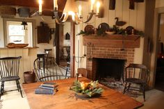 Someday I would love a fireplace in the dining room or kitchen.  Love a table in front of the fire...