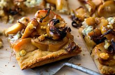 This sweet and savory apple tart is both substantial and sophisticated The chewy, pizza-like crust is fortified with three kinds of flour The topping is a comforting, mellow jumble of sweet roasted apples and shallots scented with thyme and zipped up with pungent blue cheese