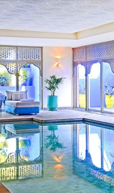 The chic indoor pool at the spa is surrounded by Moroccan lanterns and lounge beds. Marrakech, Morocco