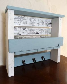 "Hall Tidy consisting of a shelf, a letter rack/storage and coat hooks. Painted with Autentico chalk paints and decoupaged with a French post card patterned napkin. [symple_toggle title=""More information"" state=""closed""] Website: OD Crafts & Up-cycling ! Submitted by: Owen Davies…"