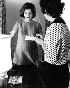 Jacqueline Kennedy (pregnant with John Kennedy Jr.) speaks with a reporter at the Kennedy Compound in Hyannis Port, shortly before the 1960 election