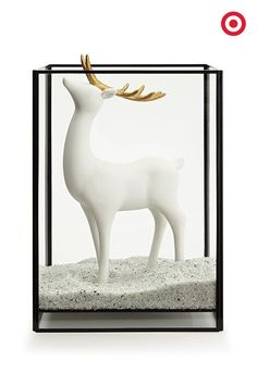 Oh, deer! That's right, give that ceramic reindeer a home in a hurricane-candleholder-turned holiday display case.