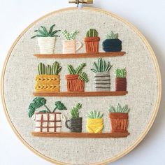 tiny houseplants on shelves embroidered hoop