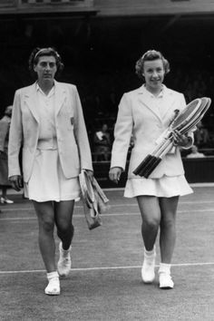 14th June 1952: Maureen Connolly (Little Mo) and Mrs I Rinkel (right) walking onto the court at Wimbledon.