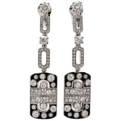 Bulgari Parentesi Enamel Diamond Gold Drop Earrings. These authentic Bulgari earrings with diamonds and black enamel are crafted in solid 18K white gold...