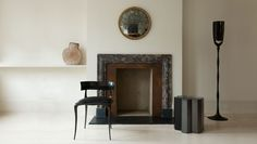 Paul Mathieu 'Aria' chair and floor lamp, patinated bronze; Christophe Delcourt side table, ceramic; Philp pot