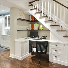 under the stairs nook/office. Interesting way to use the space