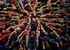 <p>The tradition of building human towers, or <em>castells</em>, dates back to the 18th century and takes place during festivals in Catalonia. Teams compete to build the tallest and most complicated <em>castells</em>. A <em>castell</em> is considered successful when it is loaded and unloaded without falling apart. The highest <em>castell</em> in history was a 10-floor structure with three people in each floor.</p>