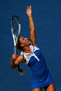 Dominika Cibulkova of Slovakia serves the ball against Roberta Vinci of Italy during their women's singles third round match on Day Six of the 2012 US Open