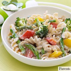 Low-fat evaporated milk makes a lightened up cheese sauce for the pasta and vegetables in this 30-minute dinner.