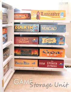 DIY Board Game Storage Units: stores games on pull-out shelves in lower cupboard, has open bookshelves on top.