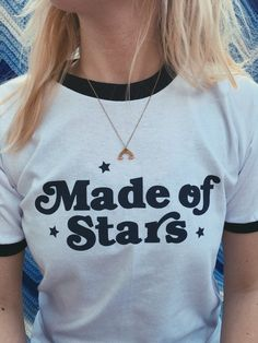 - Made of Stars Ringer Tee - Available in white with navy trim and navy graphic - Sizes S, M, L - 50% Polyester/ 50% Cotton - Made and printed in small batches in the USA