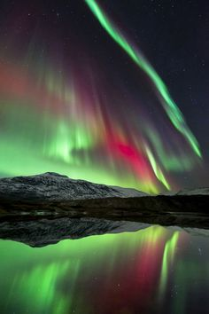 Sky Show by Tommy Eliassen - The dazzling Aurora Borealis over Høgtuva Mountain in Norway.