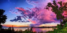 10. This stunning sunset was captured at Perry Lake in Kansas. Kansas skies are an inspiration to artists. There is nothing more beautiful than sun-painted clouds greeting a rising moon!