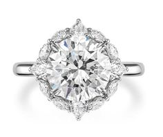 This Harry Winston round brilliant solitaire diamond engagement ring, with a pretty vintage feel, is a house classic.
