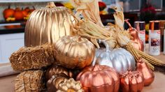 While natural pumpkins are beautiful in their original state, why not glam up your Thanksgiving table with an eye-catching metallic centrepiece? This great idea comes from the BitemeMore Girls and it's so simple! You will need: Dollar store pumpkins (also...