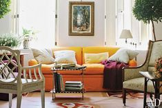 It's hard to integrate a colorful couch into an otherwise bland room. I wonder how we are going to do this.