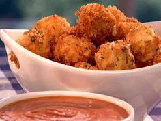 Get this all-star, easy-to-follow Food Network Fried Mozzarella Balls with Marinara Cream Sauce recipe from Patrick and Gina Neely.