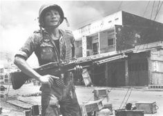 Sgt. Bui Van Hau, 38-year-old machine gunner with the Vietnamese Airborne Division, was awarded the Vietnamese Division-level Cross of Gallantry for Valor for his action in defending Saigon during the Communists' May offensive. He is shown here during the height of the fighting in the Cho Lon section of the city on May 5.