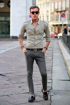 Military-styled shirt tells me tough, fitted grey pants tells me sensitive.