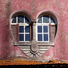 Pink building... white heart-shaped window frames