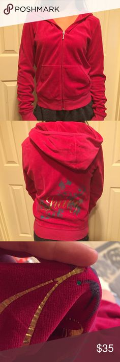 """Juicy Couture zip up jacket Juicy couture zip up jacket. Bright pink with gold writing """"juicy"""" on the back with blue rhinestones. No rhinestones are missing, and a little piece of the writing cracked off. Still great condition!! Juicy Couture Tops Sweatshirts & Hoodies"""
