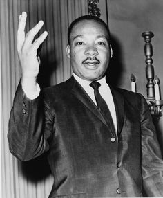 In this picture you see Martin Luther King. King was becoming famous by his non violence revolution against the racial segregation. He was murdered in 1968.