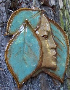 Ceramic Profile Face Surrounded by Leaves by edMUDson