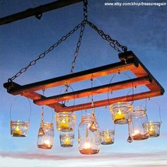 Mason Jar Chandelier DIY Candles Lanterns Luminaries Wide Mouth Ball Jar Wires Upcycled Lighting Garden Party Weddings, Jar Hangers Only Have an extra pallet laying around? Make a fun lighting concept, with mason jars hung from an old pallet. Mason Jar Chandelier, Mason Jar Lanterns, Ball Mason Jars, Diy Chandelier, Mason Jar Lamp, Outdoor Chandelier, Iron Chandeliers, Diy Candle Lantern, Diy Candles