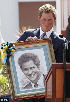 Prince Harry, that little half-smile, so like his mum.