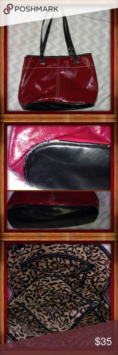 """Nine West - Red Tote Purse Nine West brand. Red tote purse with Cheetah print inside. Measures: 14x8x5"""". Faux/ synthetic. (Looks leather-ish / pleather.) Inside pockets and clasp closure. Pre-owned condition. Good condition and clean, however there is a mark/wear on the bottom lining. Not noticeable from a distance or of not looking for it. Nine West Bags Totes"""