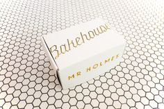 """Cake Packaging design Fonts - Designed by Aron Tzimas Country Australia Pair with Miansai """"Mr Holmes Bakehouse's Identity, Interior & Packaging was designed by CoOwner Aron Tzimas For the baked goods box, the idea was simp Baking Packaging, Cake Packaging, Brand Packaging, Pretty Packaging, Packaging Ideas, Food Branding, Branding Design, Bakery Branding, Bakery Logo"""