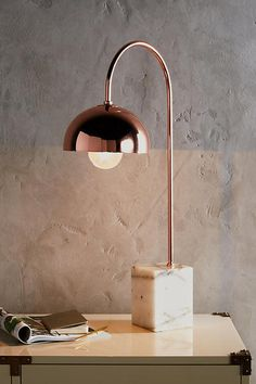 Winding Course Table Lamp by Anthropologie in Copper, Lighting Modern Lighting Design, Unique Lighting, Copper Lighting, Industrial Lighting, Lighting Ideas, Hanging Lights, Wall Lights, Cool Light Fixtures, Mid Century Chandelier