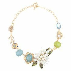 """Add a pop of style to evening ensembles and work outfits alike with this stunning gold-plated necklace, showcasing an eclectic array of seaside-inspired charms and rhinestone details.  Product: NecklaceConstruction Material: Glass, zinc alloy, pearlescent beads, rhinestone and resinColor: Green, blue and goldFeatures:  Toggle closureHigh qualty glass stonesSeaside-inspired charms  Handmade   Dimensions: Chain: 17.5""""Stones: 2"""" H x 11"""" WCleaning and Care: Avoid all oils and chemicals (such as…"""