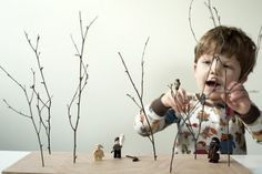 DIY instant forest -- drill holes in sanded piece of wood, gather twigs with son, voila