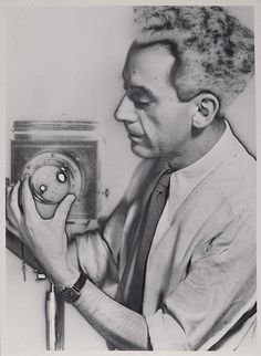 Man Ray, Self-Portrait, 1932 AMERICAN 1890-1976 Surrealist and painter, Lee Miller was his muse but it was with his darkroom experimentation that his influence was strongest, creating his 'rayograms' and solarized images.