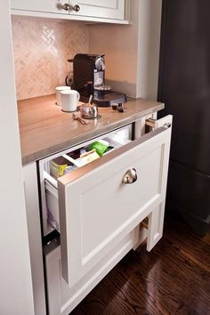Small refrigerator. An integrated fridge drawer is easy on your back and on the eye, and keeps milk and coffee beans close at hand. Of course, a mini fridge can get the job done, too.