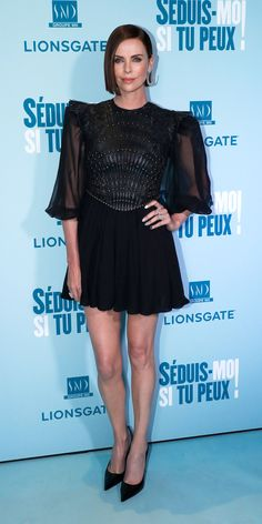 Charlize Theron served up a dark, glam look in a Christian Dior Haute Couture mini dress with lace, studs, and leather details. Charlize Theron Style, Charlize Theron Oscars, Skating Dresses, Red Carpet Looks, Costume Design, Christian Dior, Fashion Models, Lace Dress, Celebrity Style
