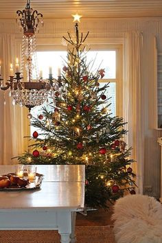 32 Beautiful Scandinavian Christmas Tree For Your Living Room - Traditionally, the Christmas tree was not put up until December, Christmas Eve, and it was taken down on January, Night. The Germans use. Merry Little Christmas, Noel Christmas, Country Christmas, Winter Christmas, Christmas Photos, Minimal Christmas, Purple Christmas, Natural Christmas, Christmas Candles