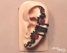 Hey, I found this really awesome Etsy listing at https://www.etsy.com/listing/246013999/red-black-gothic-ear-cuff-wire-wrapped